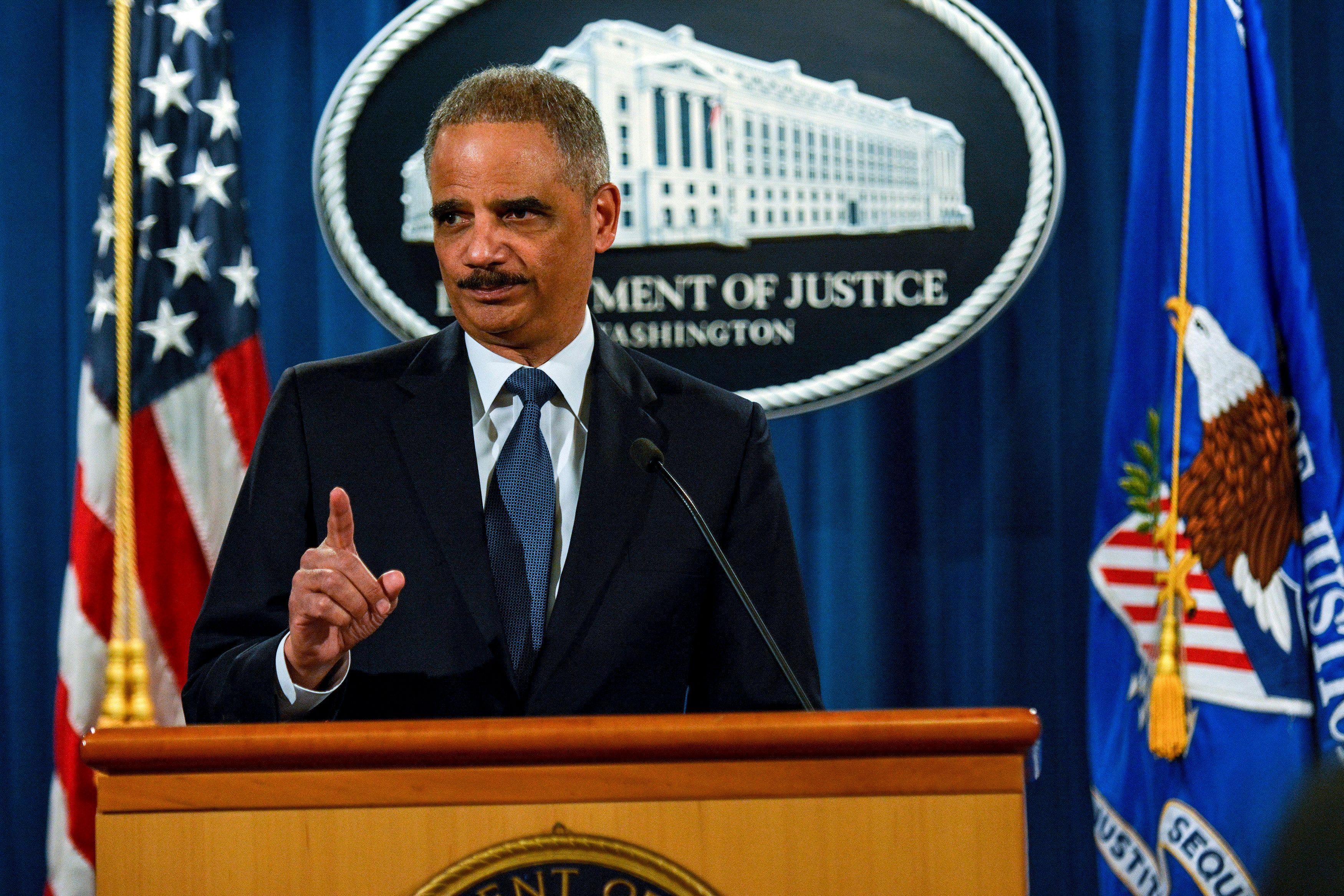 U.S. Attorney General Eric Holder addresses the Justice Department's findings in two investigations regarding the Ferguson, Missouri shooting of Michael Brown by Darren Wilson in Washington March 4, 2015. REUTERS/James Lawler Duggan   (UNITED STATES - Tags: POLITICS CRIME LAW)