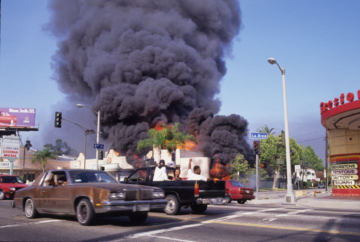 A building burns in downtown Los Angeles, 1992.