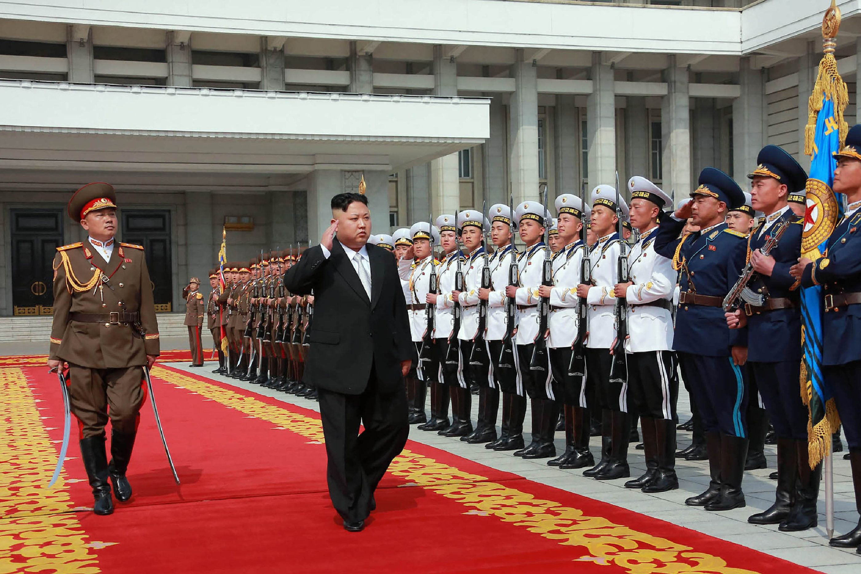 This April 15, 2017 picture released from North Korea's official Korean Central News Agency (KCNA) on April 16, 2017 shows North Korean leader Kim Jong-Un (C) arriving for a military parade in Pyongyang marking the 105th anniversary of the birth of late North Korean leader Kim Il-Sung. / AFP PHOTO / KCNA VIA KNS / STR / South Korea OUT / REPUBLIC OF KOREA OUT   ---EDITORS NOTE--- RESTRICTED TO EDITORIAL USE - MANDATORY CREDIT 'AFP PHOTO/KCNA VIA KNS' - NO MARKETING NO ADVERTISING CAMPAIGNS - DISTRIBUTED AS A SERVICE TO CLIENTS THIS PICTURE WAS MADE AVAILABLE BY A THIRD PARTY. AFP CAN NOT INDEPENDENTLY VERIFY THE AUTHENTICITY, LOCATION, DATE AND CONTENT OF THIS IMAGE. THIS PHOTO IS DISTRIBUTED EXACTLY AS RECEIVED BY AFP.  /         (Photo credit should read STR/AFP/Getty Images)