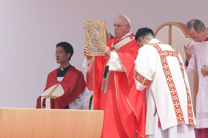 Pope Francis celebrates a Mass for the beatification of Paul Yun Ji-Chung and 123 martyr companions at Gwanghwamun Gate