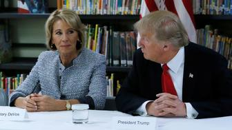U.S. President Donald Trump (R) and Education Secretary Betsy DeVos (L) meet with parents and teachers at Saint Andrew Catholic School in Orlando, Florida, U.S. March 3, 2017. REUTERS/Jonathan Ernst