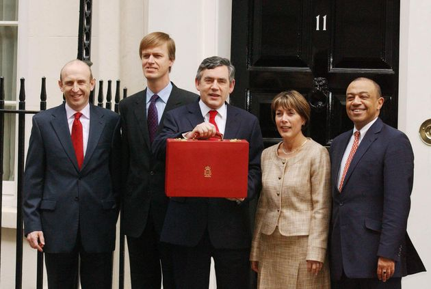 John Healey (left) as Economic Secretary in 2005, alongside Gordon Brown as he unveils the Spring