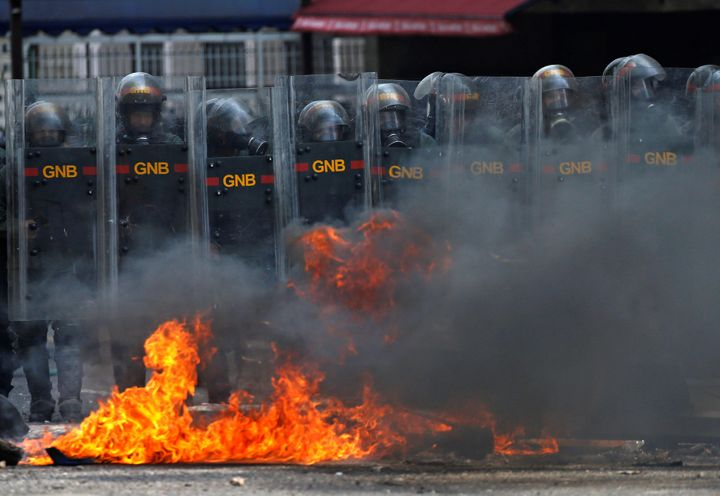 Riot police officers clash with opposition supporters during a rally against Venezuela's President Nicolas Maduro in Caracas.
