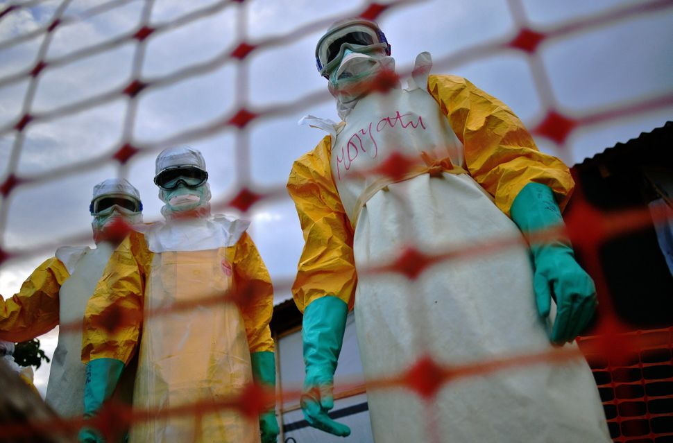 Médecins Sans Frontières staff, the first international responders on the Ebola outbreak, were overwhelmed