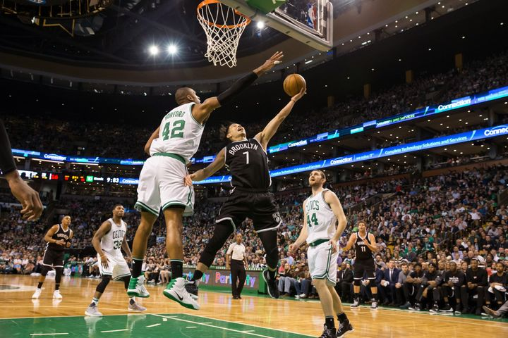 Jeremy Lin of the Brooklyn Nets drives to the basket against the Boston Celtics on April 10 in Boston.
