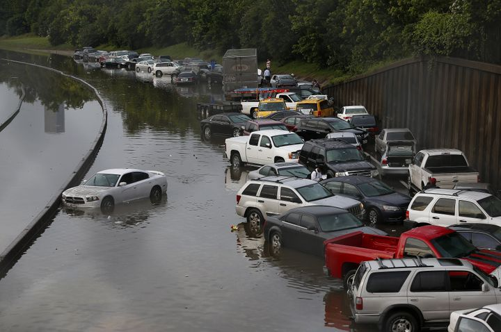 Vehicles are left stranded on a highway in Houston after torrential rains on May 26, 2015. Rainfall reached up to 11 inches i