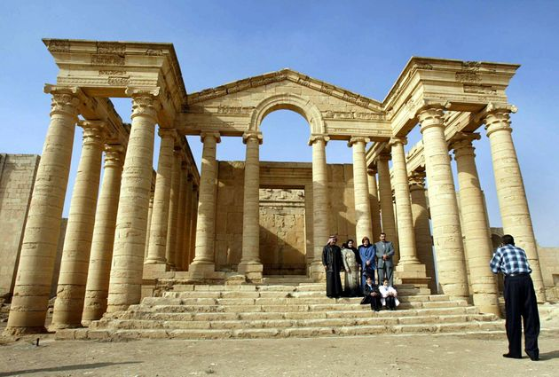 Arab foreigners take a picture in front of a temple in the historic city of Hatra in December