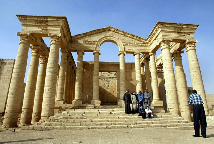 Arab foreigners take a picture in front of a temple in the historic city of Hatra in December 2002