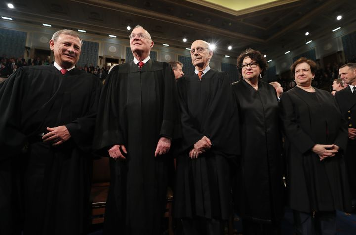 Led by Chief Justice John Roberts, left, a majority of the justices of the Supreme Court appeared bothered by the government'
