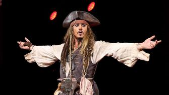 ANAHEIM, CA - AUGUST 15:  Actor Johnny Depp,  dressed as Captain Jack Sparrow, of PIRATES OF THE CARIBBEAN: DEAD MEN TELL NO TALES took part today in 'Worlds, Galaxies, and Universes: Live Action at The Walt Disney Studios' presentation at Disney's D23 EXPO 2015 in Anaheim, Calif.  (Photo by Jesse Grant/Getty Images for Disney)