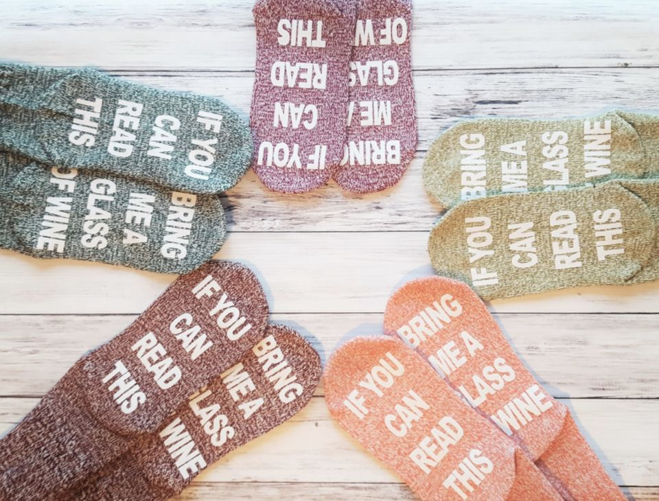 """$10 (and up), Etsy/Snowy Palms. <a href=""""https://www.etsy.com/listing/480435027/wine-socks-if-you-can-read-this-bring-me?ga_o"""