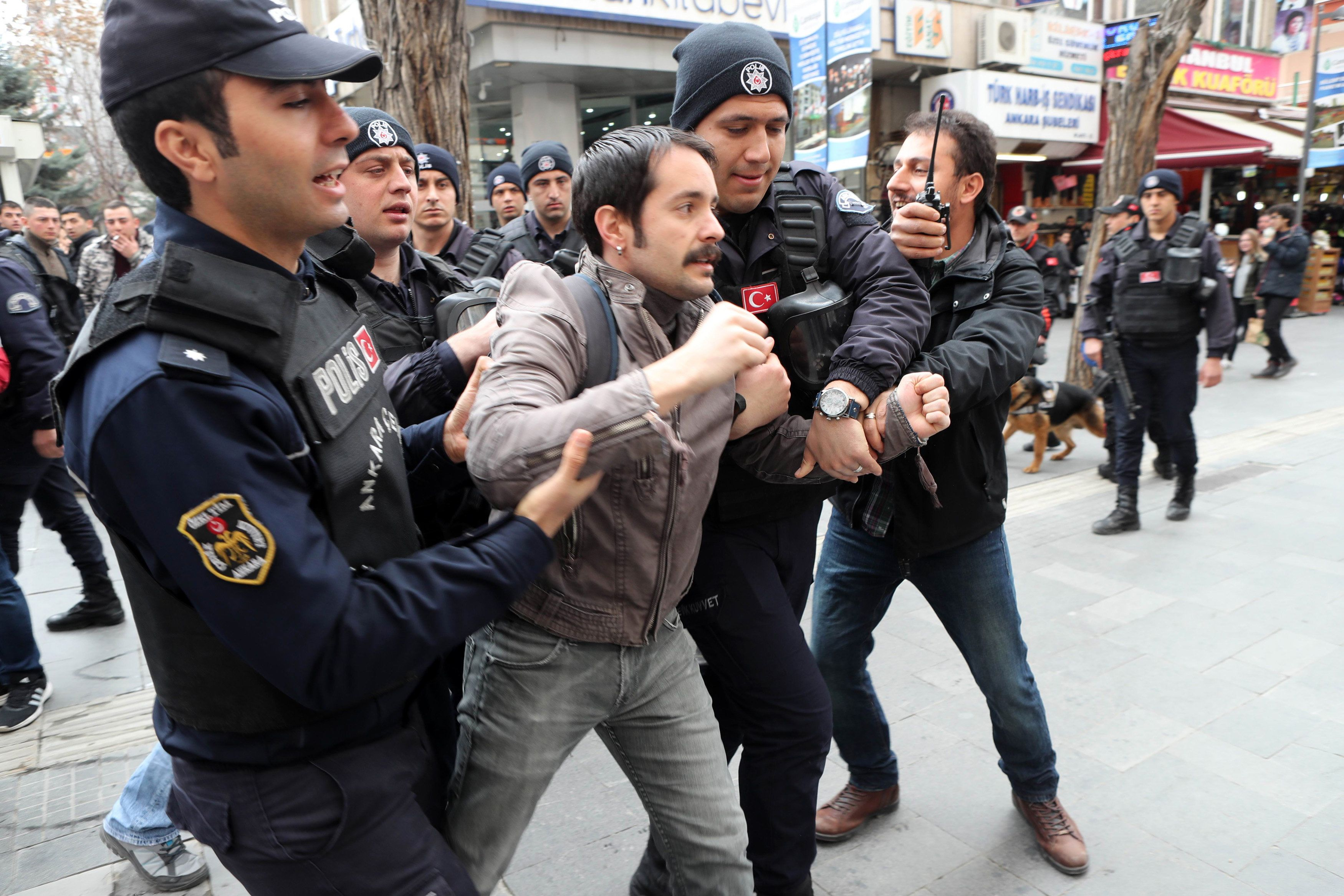 Turkish policemen arrest a protester during a demonstration  on March 11, 2017 in Ankara.   Turkish journalists and opposition lawmakers protested in Istanbul on March 11, 2017, against the detention of reporters, as a crackdown on the media has accelerated after the failed coup against President Recep Tayyip Erdogan. 'Journalism is not a crime' and 'We will not remain silent,' chanted the crowd of some 50 people, who railed against the conditions the journalists are held in.  / AFP PHOTO / ADEM ALTAN        (Photo credit should read ADEM ALTAN/AFP/Getty Images)