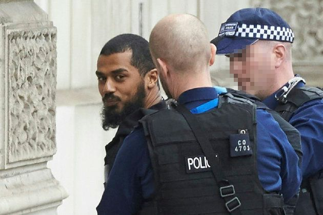 Police detain a man near Downing Street and Parliament on Thursday