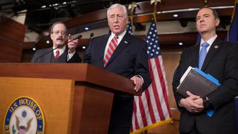 UNITED STATES - FEBRUARY 15: House Minority Whip Steny Hoyer, D-Md., center, Reps. Adam Schiff, D-Calif., right, and Eliot Engel, D-N.Y., conduct a news conference in House Studio A on legislation that would require congressional approval to lift sanctions on Russia, February 15, 2017. (Photo By Tom Williams/CQ Roll Call)