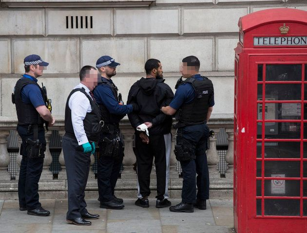 The man was handcuffed and detained against a wall on Whitehall,