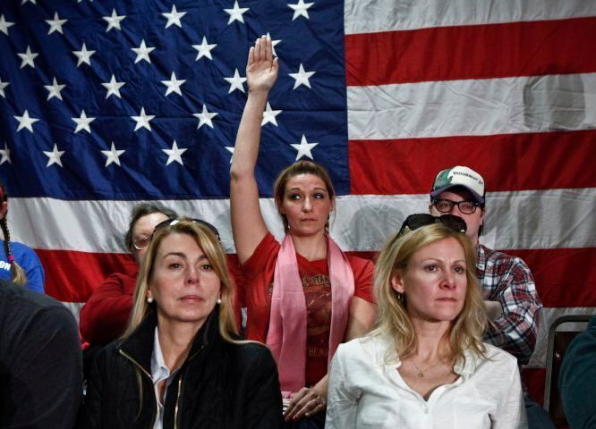 A woman raises her hand during a Town Hall meeting with New Jersey Gov. Chris Christie on Feb. 19, 2014 in Middletown, N.J, f