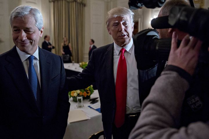 Trump stands next to Jamie Dimon, CEO of JPMorgan Chase & Co., in the White House on February 3.