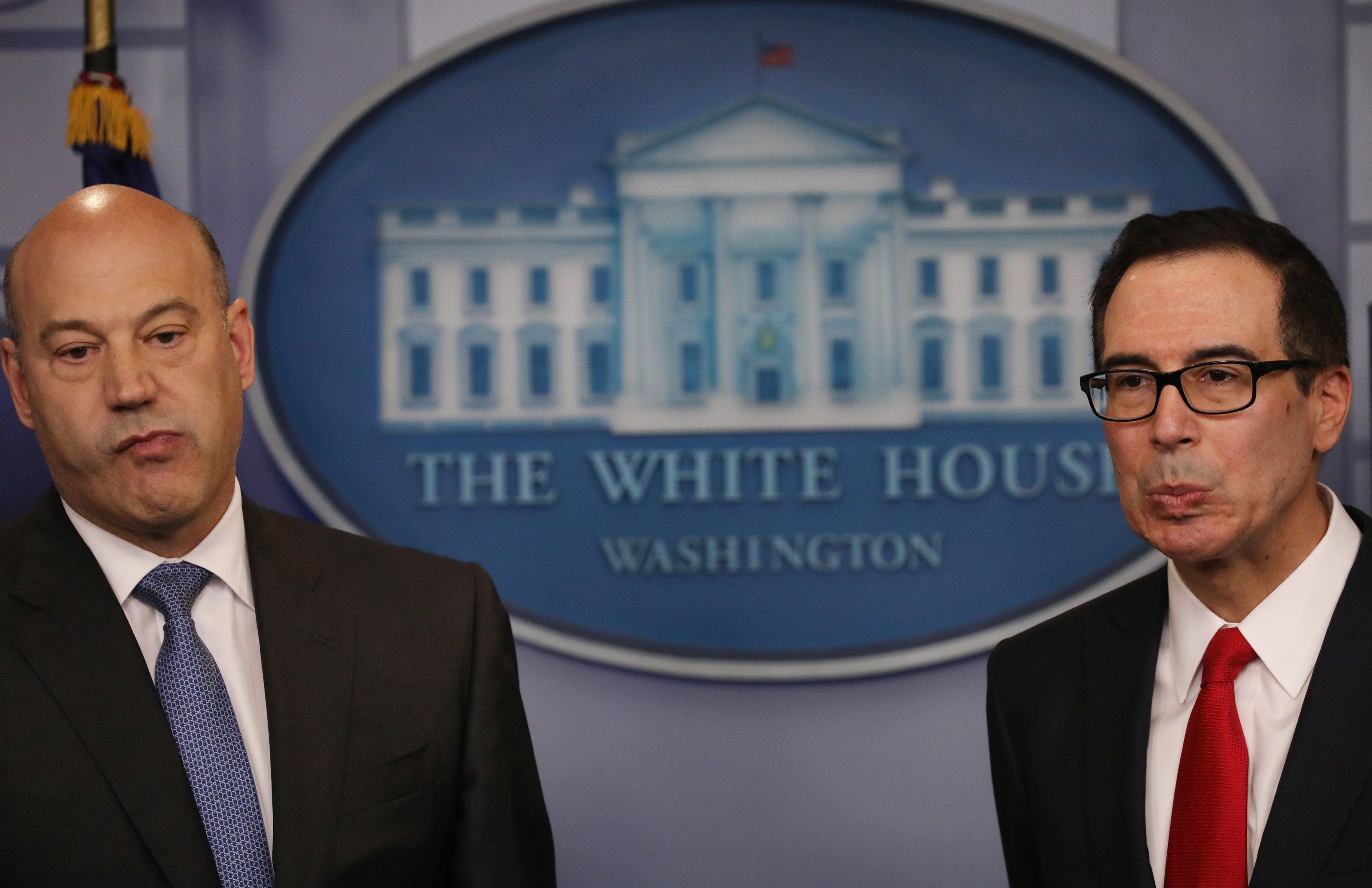 National Economic Director Gary Cohn (left) and Treasury Secretary Steven Mnuchin take questions while unveiling the Tru