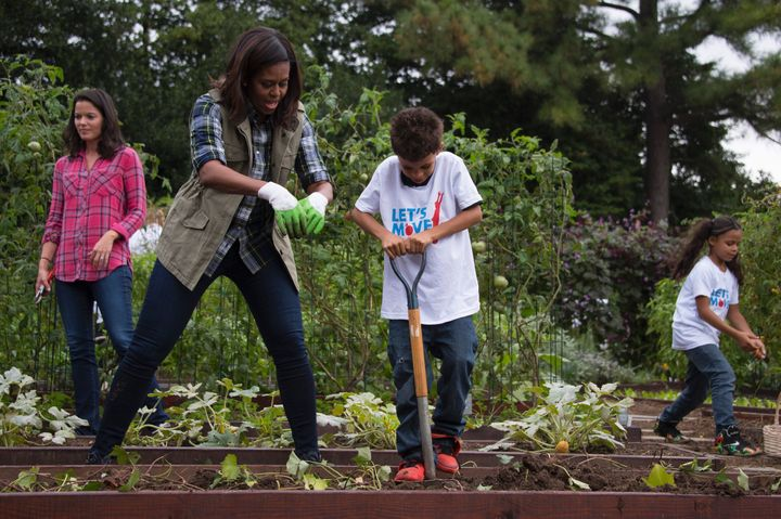 Former first lady Michelle Obama helping kids in the White House Kitchen Garden.