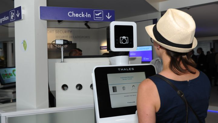A traveler tries out a biometric scanning system at the Paris Air Show.