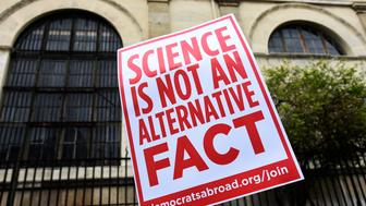 PARIS, FRANCE - APRIL 22: As part of a global movement March for Science protesters march to demonstrate on April 22, 2017 in Paris to oppose Trump's rejection of science,  climate change, global warming and the rise of misinformation. (Photo by John van Hasselt/Corbis via Getty Images)