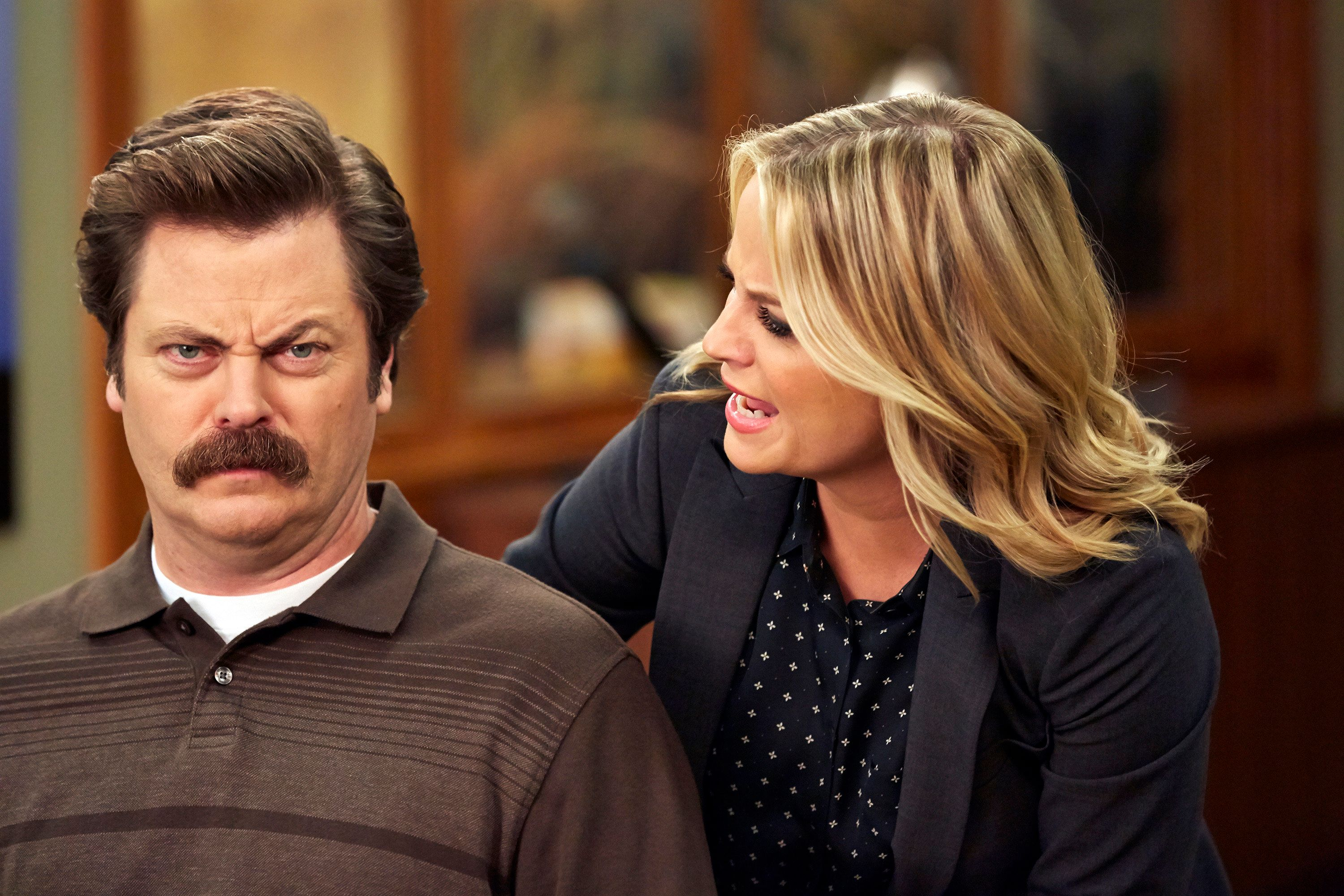 PARKS AND RECREATION -- 'Funkin' Gonuts' Episode 704 -- Pictured: (l-r) Nick Offerman as Ron Swanson, Amy Poehler as Leslie Knope -- (Photo by: Ben Cohen/NBC/NBCU Photo Bank via Getty Images)