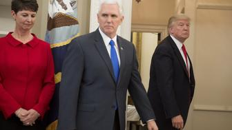 US President Donald Trump leaves alongside US Vice President Mike Pence (C), after speaking about signing executive orders on trade policies in the Oval Office of the White House in Washington, DC, March 31, 2017. / AFP PHOTO / SAUL LOEB        (Photo credit should read SAUL LOEB/AFP/Getty Images)