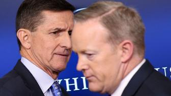 National security adviser General Michael Flynn (L) arrives to deliver a statement next to Press Secretary Sean Spicer during the daily briefing at the White House in Washington U.S., February 1, 2017. Picture taken February 1, 2017. REUTERS/Carlos Barria