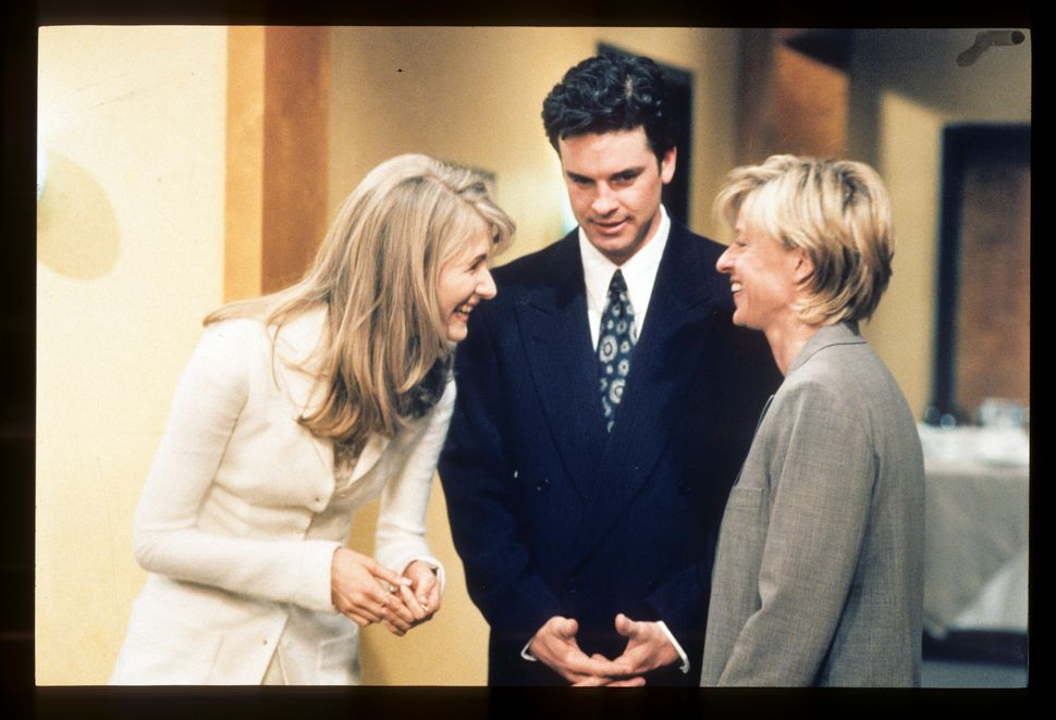 "Laura Dern, Steven Eckholdt and Ellen DeGeneres share a moment during the filming of ""The Puppy Episode,"" the episode in"