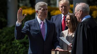 WASHINGTON, DC - APRIL 10: President Donald Trump watches as Supreme Court Justice Anthony Kennedy administers the judicial oath to Judge Neil Gorsuch during a swearing-in ceremony in the Rose Garden of the White House in Washington, DC on Monday, April 10, 2017. (Photo by Jabin Botsford/The Washington Post via Getty Images)