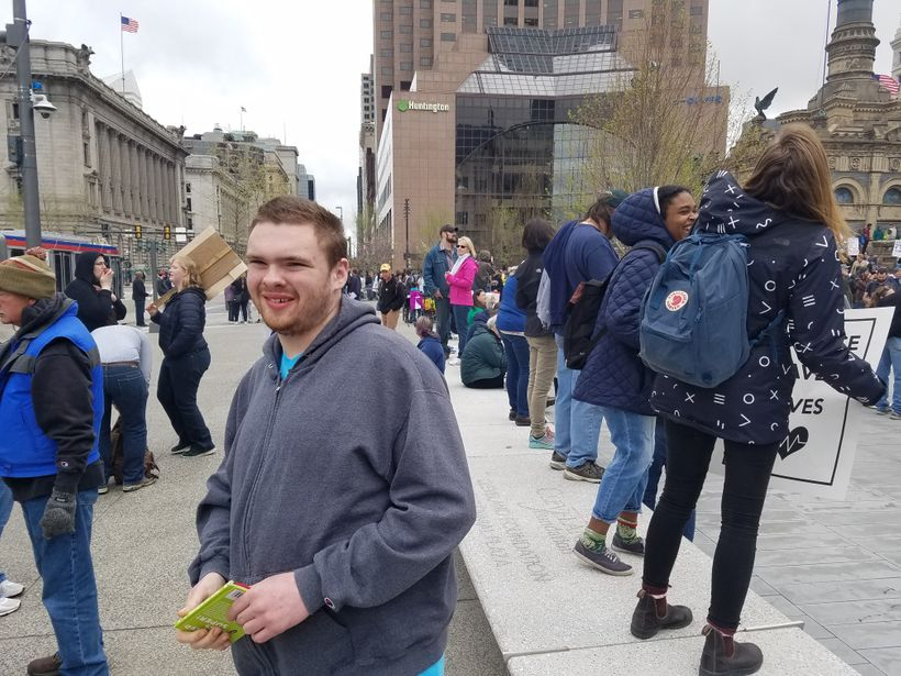 Ben loves reading, and he really seems to be enjoying the various signs at the Cleveland Science March and Rally.