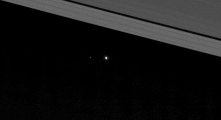 In this zoomed-in image of the previous picture, the moon can be seen to the left of Earth.