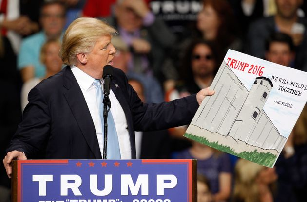Donald Trump promises to build a wall between the U.S. and Mexico at a campaign rally in Fayetteville,...