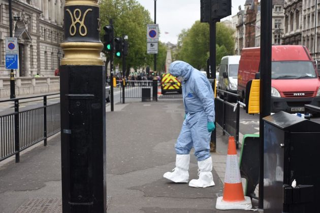British police take security measurements near the Houses of Parliament in central London on April