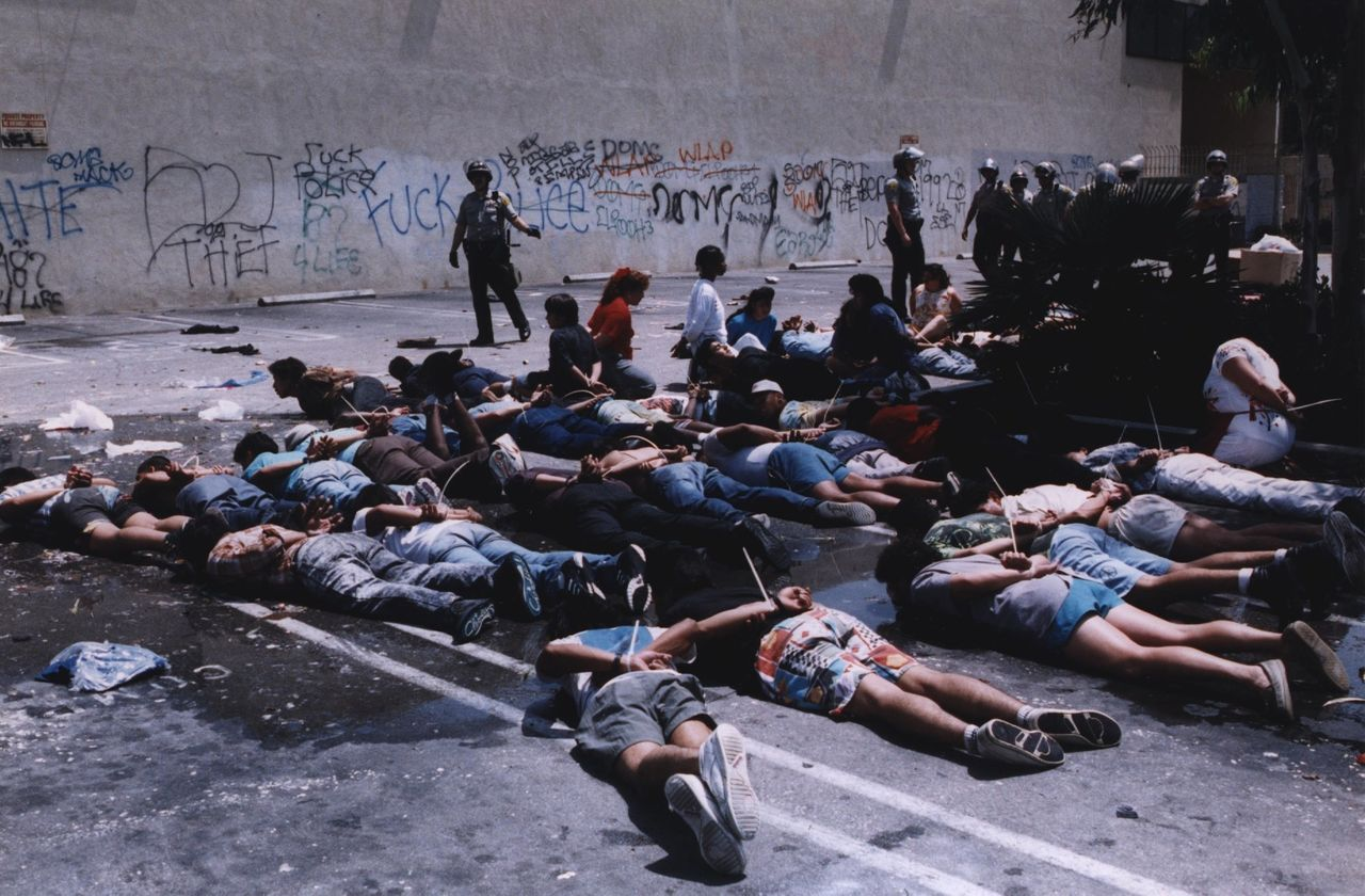 Los Angeles County Sheriff's Department officers surround alleged looters on Vermont at Martin Luther King Jr. Boulevard on April 30, 1992.