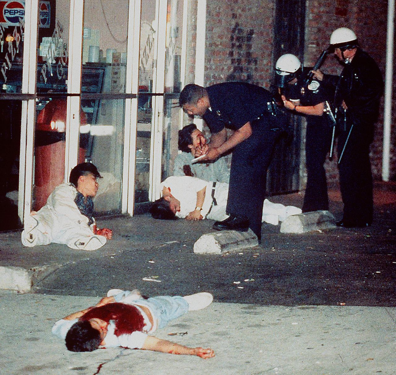 Edward Song Lee, 18, foreground, was shot to death and three other people were injured at 3rd and Hobart streets in Los Angeles' Koreatown on April 30, 1992. Police questioned the survivors of the attack, who were shot while trying to protect a Korean-owned pizza parlor.