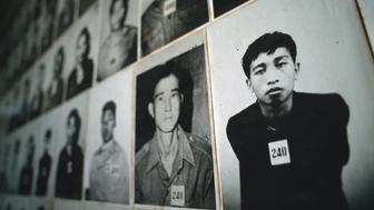 CHOEUNG EK, CAMBODIA - 1993/02/01: Hundreds of photographs line the walls of the Tuol Sleng Museum in Phnom Penh. The museum is in a former school that the Khmer Rouge turned into Prison S-21. It is documented that over 17,000 Cambodians were held, tortured and killed in this prison. The photographs depict some of the prisoners killed in this prison. The museum serves as a constant reminder of the genocide under the Khmer Rouge during the Pol Pot years.. (Photo by Peter Charlesworth/LightRocket via Getty Images)