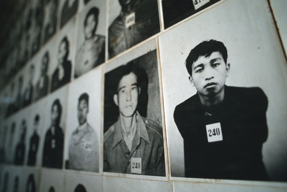 Hundreds of photographs of prisoners line the walls of the Tuol Sleng Museum in Phnom Penh. The museum is in a former school