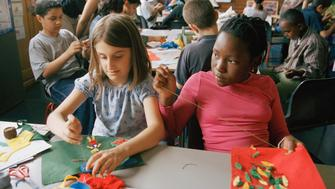 Year 6 pupils at Millfields Community School do a special art workshop which uses creative sewing techniques.This is a large inner-city primary school with 604 children on its roll. It is a happy and high achieving school despite significant levels of poverty among many of its families and the fact that more than 74% of the pupils speak English as an additional language. Children from many racial and cultural backgrounds have been successfully integrated and a large number of Muslim children (around 40% of the pupils) attend the school. It has been hailed as 'a national leader' for raising educational standards, successful inclusion of children with special needs into mainstream schooling, and the diversity of its pupils who in total speak over 40 languages. (Photo by Gideon Mendel/Corbis via Getty Images)