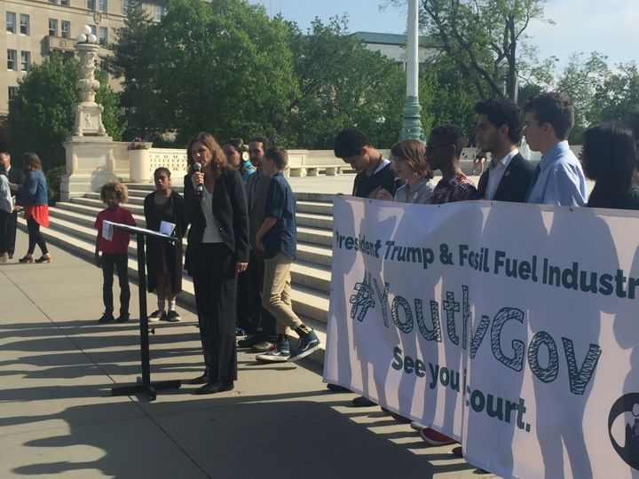 Speaking at the steps of the Supreme Court, alongside 14 of the 21 young plaintiffs in <em>Juliana v. U.S.</em>, suing the fe