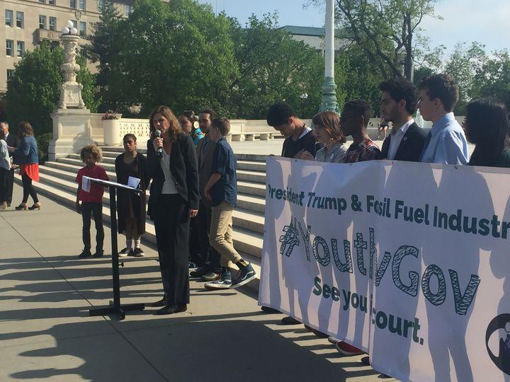 Speaking at the steps of the Supreme Court, alongside 14 of the 21 young plaintiffs in <em>Juliana v. U.S.</em>, suing the fe