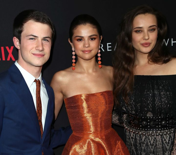 Selena Gomez with the show's stars Dylan Minnette and Katherine Langford.