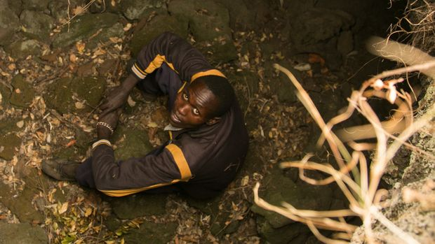 Amos Kiptui 27 sits in a cave in a remote part of Kenya where an outbreak of cutaneous leishmaniasis has plagued the local community Kiptui has been suffering from the disease  which eats away at the top layers of skin  for some years