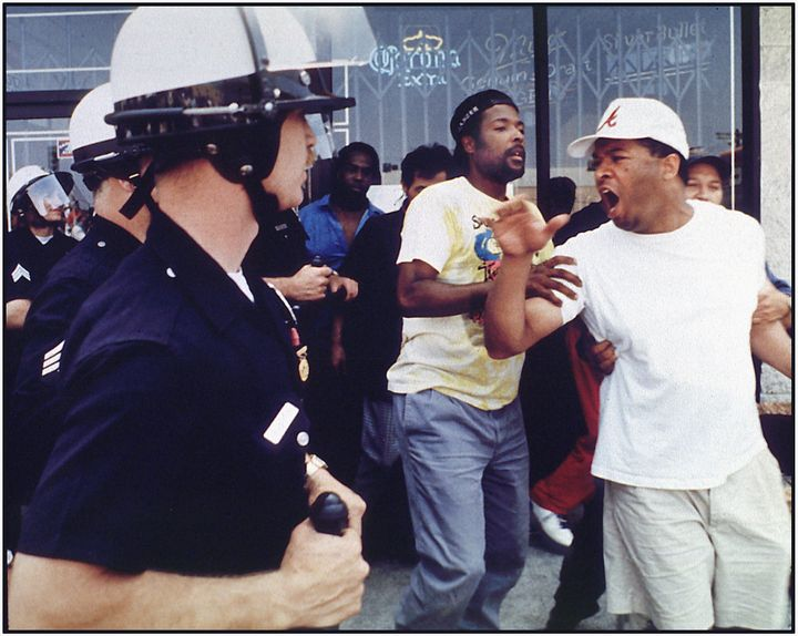 An argument between police and civilians preceding a rock and brick throwing incident at the corner of Vermont and 1st Street