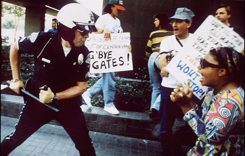 A police officer uses his baton on a protester at the corner of First Street and Broadway on April 29, 1992, in Los Angeles.