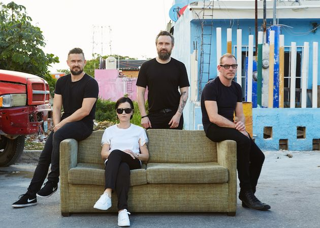 For two decades, where The Cranberries go, their trusty sofa