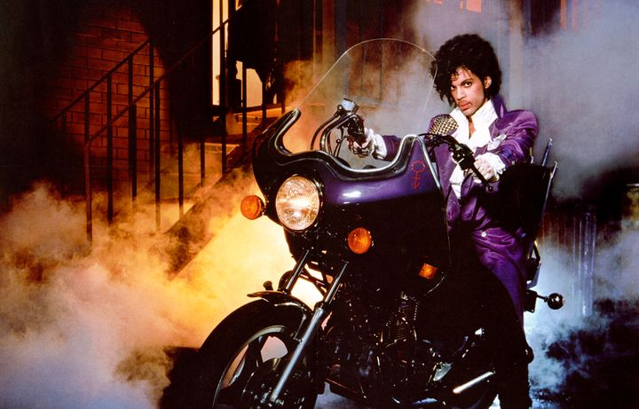 "Prince on the movie poster for ""Purple Rain."""