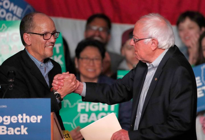 DNC chair Tom Perez, left, greets Sen. Bernie Sanders (I-Vt.) at a rally in Salt Lake City on April 21, 2017. The event