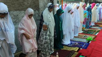 JAKARTA RAYA, JAKARTA, DKI JAKARTA, INDONESIA - 2016/09/12: Muslim women join together to pray Eid al-Adha in the area of Kebayoran Lama, Jakarta. Eid al-Adha, or feast of sacrifice is celebrated by Muslims worldwide to commemorate the Prophet Abraham's test of faith. During the Eid Al-adha, Muslims slaughter cattle and distribute the meat to the poor. (Photo by Sutrisno Jambul/Pacific Press/LightRocket via Getty Images)