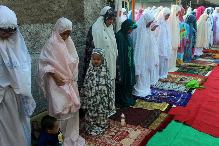 Muslim women join together to pray Eid al-Adha in the area of Kebayoran Lama, Jakarta, on Sept. 12, 2016.